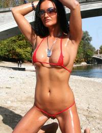 A girl stripping out of her bikini on the Rarawa Nudist Image 9