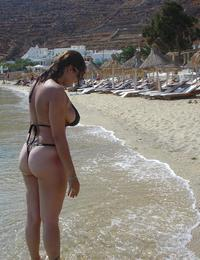 A bikini cutie going topless on the Cap d'Agde Image 12