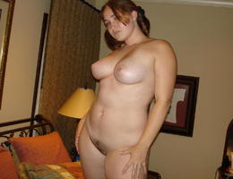 Chubby bitch posing on her bed set Image 2