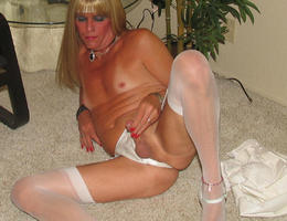 A crossdresser posing in heels and stockings gelery Image 5