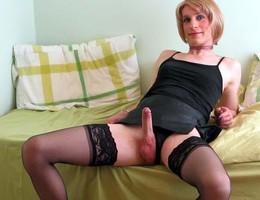 A crossdresser posing in heels and stockings gelery Image 8