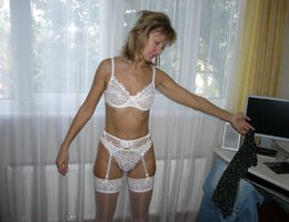 Amateur babe posing in lingerie collection Image 6