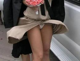 A girl in white dress in this upskirt galery Image 9