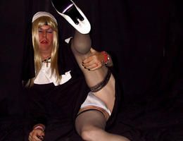 Crossdresser posing in beautiful lingerie gallery Image 1